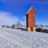 Wintertijdmening in het dorp van Stoos, Zwitserland Stock Foto's