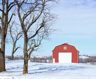 Wintertime Barn. A red barn in the winter stock photography
