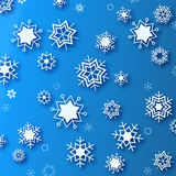 Wintertime - blue background with white beautiful snowflakes Stock Photography