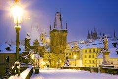 Wintertime Charles bridge, gothic Lesser Town bridge tower, Less. Winter snowy Charles bridge, gothic Lesser Town bridge tower, Lesser town district, Prague royalty free stock photography
