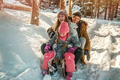 Wintertime. Happy funny winter family action royalty free stock photos