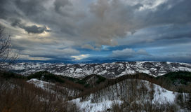 Wintertime landscape featuring snowy mountain Stock Photography