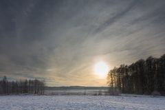 Wintertime sunset over meadow Stock Photography