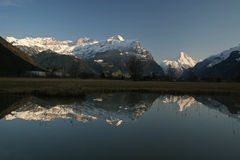 Wintertime in Switzerland. Reflection of the snowy montains at the shore of the lake of Lucerne Stock Photography