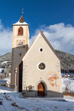 A wintertime view of a small church with a tall steeple Royalty Free Stock Images
