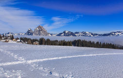 Wintertime view in the village of Stoos, Switzerland. Stoos, Switzerland - 24 January, 2017: wintertime view with summits of Kleiner Mythen and Grosser Mythen Stock Photography