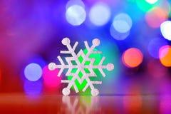 Winterurlaub-Schneeflocke Hintergrund, Bokeh Stockfoto