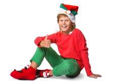 Winterurlaubweihnachtskonzept - Junge in Sankt Lizenzfreie Stockfotos