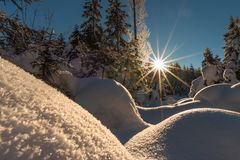 Winterwonderland in Austria with sunshine and deep snow. The Almtal in the Upper Austrian Alps is one of the most beautiful places to be in winter. Deep snow, a Stock Photography