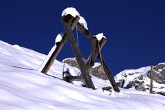 Winterwonderland. Swing with a view along hiking trail to Brunnihütte Stock Image