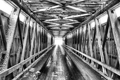 Wintery Bridge. Love the architecture and history while looking through this covered bridge mid winter. This covered bridge is located in Centerville, Michigan Stock Photos