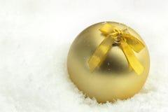 Wintery chrismas ball in snow. Winter chrismas ball in snow Stock Photography