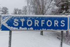 A wintery cross road with a sign. To Storfors Royalty Free Stock Photo
