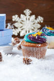 Wintery cupcakes on a snow background Stock Image