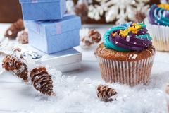 Wintery cupcakes on a snow background Stock Photo