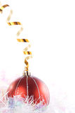 Wintery Decorations. Christmas ornaments with gold ribbons Royalty Free Stock Photography