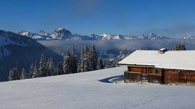 Wintery landscape and old timber hut near Gstaad Royalty Free Stock Photos