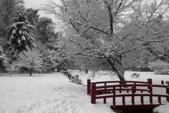 Wintery scene with red bridge stock photography
