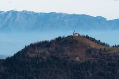 Wintery scene of St. Jacob catholic church on top of the hill in Slovenia stock photography