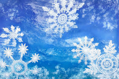 Wintery Snowflakes Against a Blue Background. Several large snow flakes being carried by the blustery winds in this cool blue wintery scene stock illustration