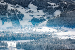 Wintery village in alpine valley, Tyrol, Austria Royalty Free Stock Photos