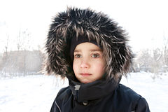 Wintery young boy portrait Stock Images