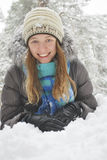 Wintet, lies the beautiful long-haired girl in the snow. Stock Image