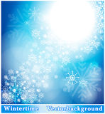 Wintry background. With snowflakes in blue Royalty Free Stock Photography
