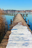 Wintry boardwalk at starnberg lake, germany Royalty Free Stock Photos