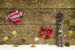 Wintry christmas decoration with ski and winter clothes on woode Stock Photography