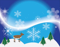 Wintry Christmas Scene With Rudolph. Rudolph the red-nosed reindeer enjoys a wintry day. Christmas background Royalty Free Stock Photography