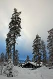 Wintry cottage in heavy snow Royalty Free Stock Photography