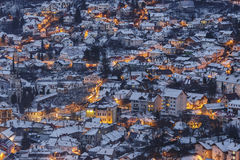Wintry dusk aerial view in Brasov. Wintry aerial view of a residential district of Brasov city at dusk, Romania Royalty Free Stock Image