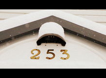Wintry house address Stock Photography