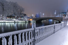 Wintry landscape in Tampere. Frosty fence and Tammerkoski river in the center of Tampere, Finland in a wintry landscape Royalty Free Stock Photography