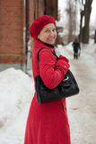 Wintry  mature lady walking Stock Images