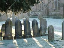 Wintry Morning Graveyard. Early morning sun in graveyard royalty free stock image