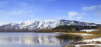 Wintry mountains and lake Stock Image