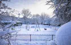 Wintry Outdoor Playground in United Kingdom. Park playground in snowy winter at early morning in England, UK stock images