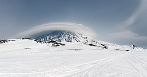 Wintry panoramic mountain landscape of Kamchatka: view of active Koryaksky Volcano Royalty Free Stock Image