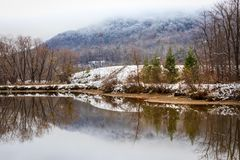 Wintry pond. A wintry pond in the mountains surrounded with snow Royalty Free Stock Photography