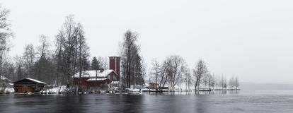 Wintry riverside. With building in Finland Royalty Free Stock Image