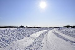 Wintry road and sun Royalty Free Stock Image