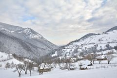Wintry rural mountain scenery in the valleys of Bucegi mountains in Magura village Stock Images