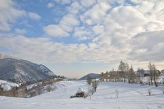 Wintry rural mountain scenery in the valleys of Bucegi mountains in Magura village, Brasov county, Romania. Royalty Free Stock Photography