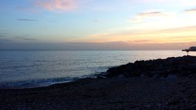 One of January`s beautiful sunsets. A wintry sunset in a clear sky over a pebbly beach, England Royalty Free Stock Image