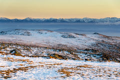 Wintry sunset in Vitosha mountain, Bulgaria. Colorful sunset panorama with Rila mountain in background Royalty Free Stock Photo