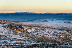 Wintry sunset in Vitosha national park, Bulgaria. Colorful sunset panorama with Rila mountain in background Royalty Free Stock Images