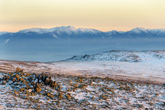 Wintry sunset in Vitosha mountain, Bulgaria. Colorful sunset panorama with Rila mountain in background Royalty Free Stock Image