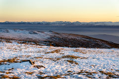 Wintry sunset in Vitosha mountain, Bulgaria. Colorful sunset panorama with Rila mountain in background Stock Images